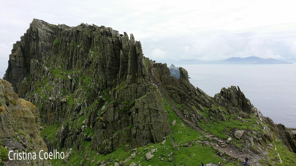 View of the cliff that protects the monastery and part of the stone staircase. Ireland in the background - Skellig Michael